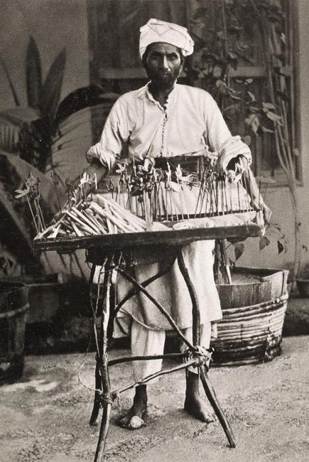Snouck Hugronje didn't always remove the backgrounds in his portraits. Here a sweet-seller is portrayed as one amongst a myriad different 'types' in Jeddah. Süssigkeitskrämer [sweet-seller] by Christian Snouck Hurgronje, ca. 1888. 1781.b.6/55