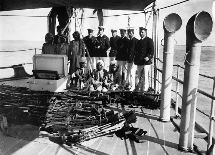 The Dubai Incident: rifles surrendered by the Sheikh of Dubai, displayed on the deck of HMS Fox. Library of Congress Prints and Photographs Online Catalog (Public Domain)