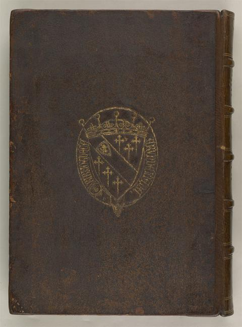 The Arundel coat of arms inscribed with the words Bibliotheca Arundeliana ('Arundel Library') on a manuscript cover. Arundel Or 52