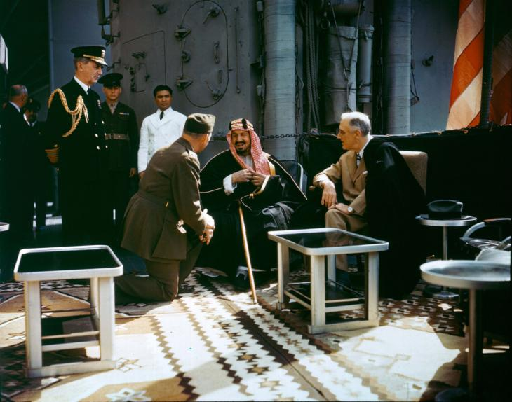 President Franklin D Roosevelt and King Ibn Sa'ūd on board USS Quincy (CA-71) in February 1945. Public Domain