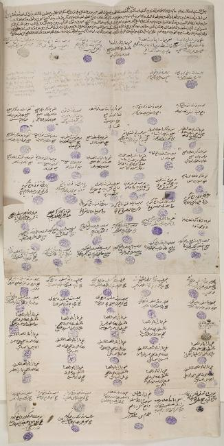 View of the full, unfolded document bearing the witness statement and signatures of ninety men, of which eighty-three are described as prominent inhabitants. IOR/R/15/1/235, f. 60