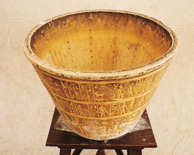 Egyptian water-clock. Copy of a conical alabaster vase with columns of 12 holes. Astronomical signs decoration on the outer surface. Image courtesy of Getty Images DEA Picture Library